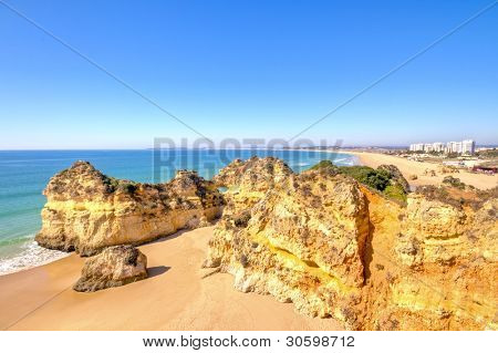 Rocks and ocean at Praia Tres Irmaos in Alvor Algarve Portugal