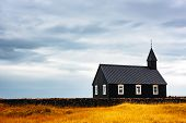 Picturesque autumn landscape with famous picturesque black church of Budir at Snaefellsnes peninsula poster