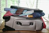 Full suitcase packed for vacation without more space poster