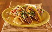 Tacos on a platter with tortillas - mexican food