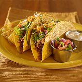 image of mexican food  - Tacos on a platter with tortillas  - JPG