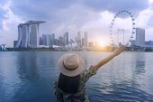 Woman Hipster Is Enjoy Traveling And Sightseeing Good View In Singapore City. poster