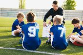 Football Coach Coaching Kids. Soccer Football Training Session For Young Boys. Young Coach Teaching  poster