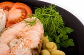 Boiled delicious salmon with vegetables and spicy herbs poster
