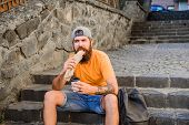 Meal Just Tastes Better Out. Hipster Eating Hot Dog Meal On Stairs Outdoor. Caucasian Guy Enjoy Eati poster