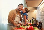 Happy Family Father With Child Daughter  Preparing Vegetable Salad At Home poster