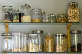 Pantry Or Kitchen Shelf With Assorted Dried Food Ingredients In A Variety Of Different Glass Storage poster
