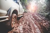 Dirty Offroad Car, Suv Covered With Mud On Countryside Road, Off-road Tires,  Offroad Travel  And Dr poster