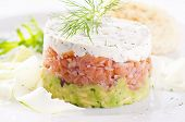 stock photo of tatar  - Salmon Tatar with avocado and dill cream - JPG