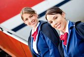 image of air hostess  - Friendly air hostesses smiling and welcoming into the airplane - JPG