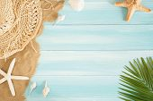 Op View Of Sea Straw Hat And Sea Shells On The Sea Sand On A Blue Wooden Background, Summer Concept  poster