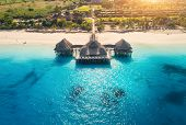 Aerial View Of Beautiful Hotel In Indian Ocean At Sunset In Summer. Zanzibar, Africa. Top View. Land poster