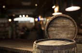 Beer Barrel With Beer Glasses On A Wooden Table. The Dark Brown Background. poster