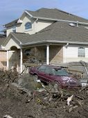 picture of katrina  - destroyed home and car about 100 ft - JPG