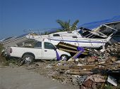 foto of katrina  - boat lands on truck after being carried by flood waters of hurricane katrina - JPG