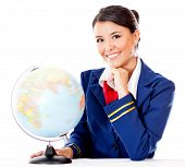Flight attendant with the globe choosing the next destination - isolated over white poster