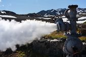 View Of Emission Mineral Thermal Steam-water Mixture From Geological Well In Geothermal Deposit Area poster