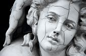 stock photo of stone sculpture  - Cracked face of ancient female Greek sculpture - JPG