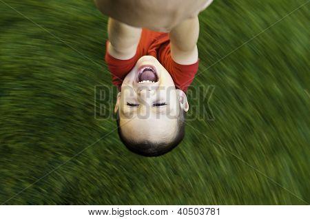 childing being spun in circles