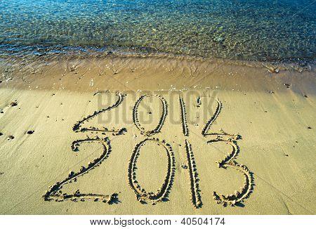 New year calendar on a sand beach