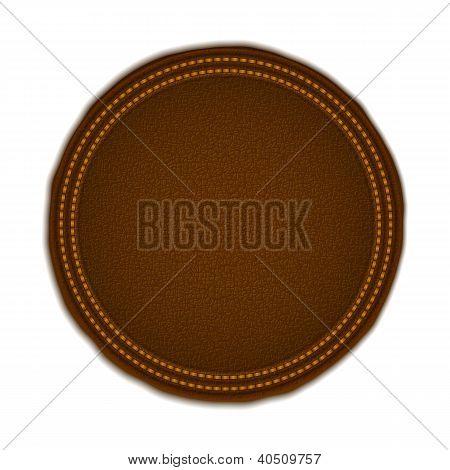 Insignia redonda de cuero