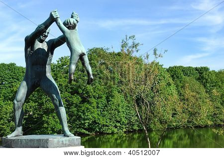 Sculpture Of A Man Playing With A Child