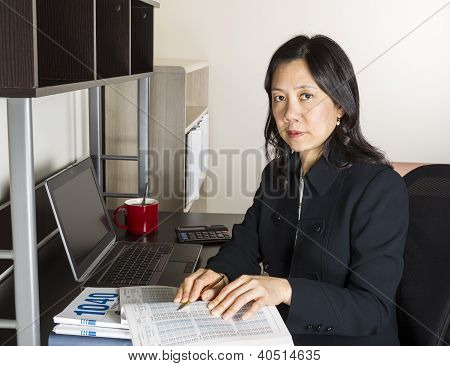 Professional Mature Woman Income Tax Accountant At Work