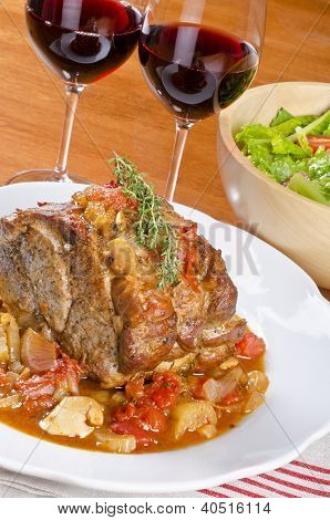 Roasted Pork Served with Red Wine and Salad
