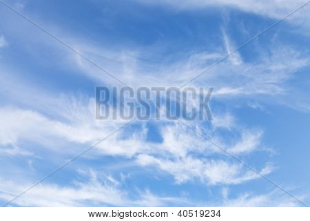 Several Swirling Small White Clouds