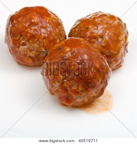 Three Meatballs Under Meat Sauce