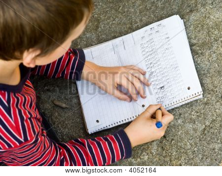 Boy Doing Writing Homework