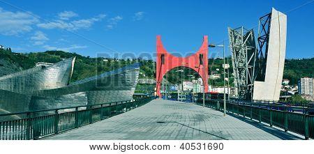 BILBAO, SPAIN - NOVEMBER 16: Panoramic view of Guggenheim Museum and Principes de Espana Bridge on November 16, 2012 in Bilbao, Spain. The museum was designed by Frank Ghery