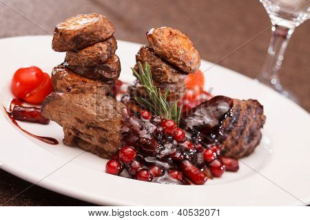 beef steak with potatoes and cranberry sauce