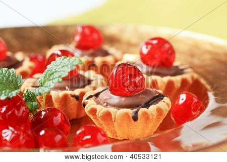 cupcakes filled with chocolate and decorated with candied fruit