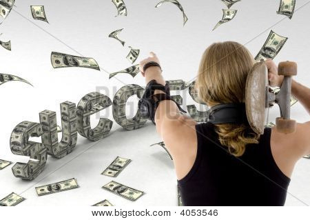 Young Male Looking At Flying Dollars And Holding Skateboard