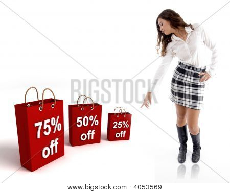 Pretty Woman Pointing The Shopping Bags