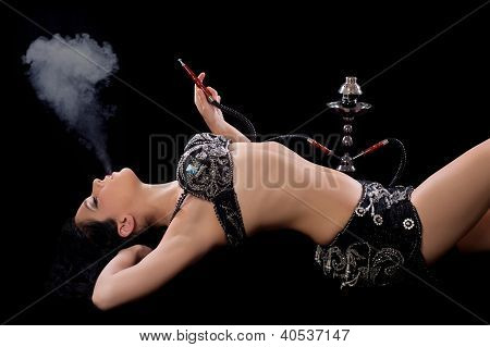 Belly dancer smoking a hookah pipe