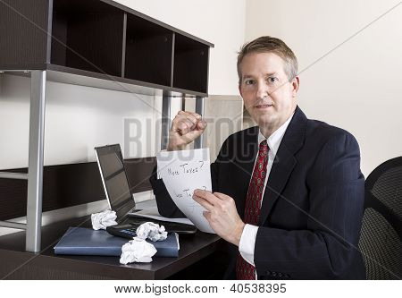 Mature Man Being Positive While Working On Income Taxes