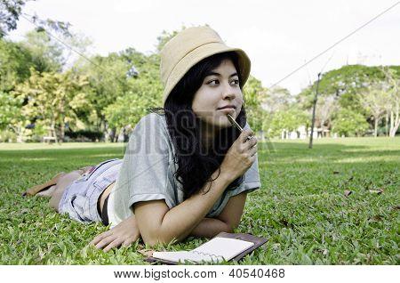 Woman Thinking Hard Studying Outside