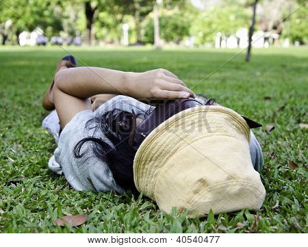 Exhausted Student Over The Grass