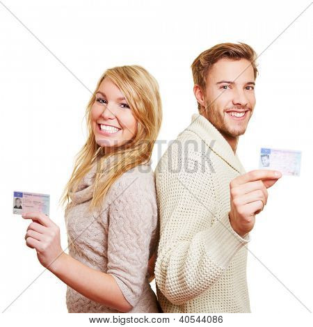 Young happy couple with their new European driving licence