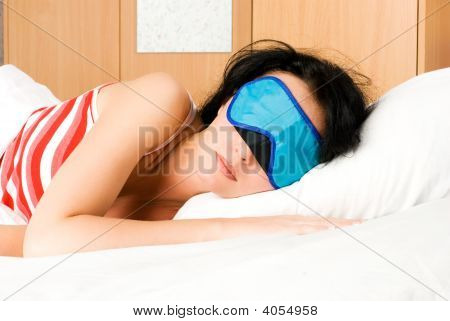 Young Brunette Woman Sleeps With A Band On Her Eyes