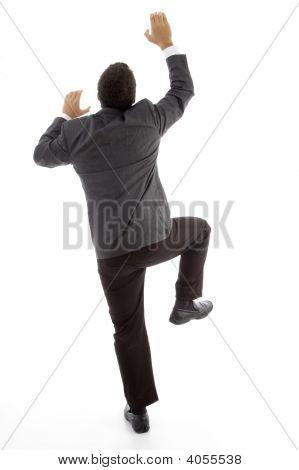 Back Pose Of Climbing Executive