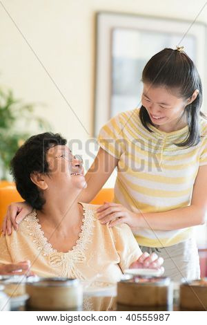 Asian Chinese family interaction inside a restaurant
