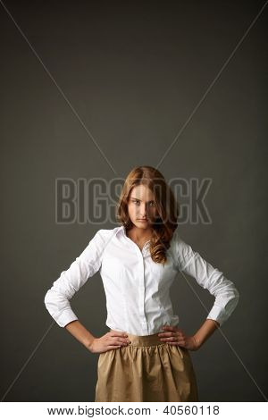 Image of serious woman in smart casual looking at camera