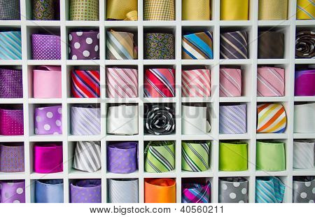 Shelf full of fine silk neckties on a Chinese street market