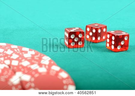 Poker Gambling Chips On A Green Playing Table