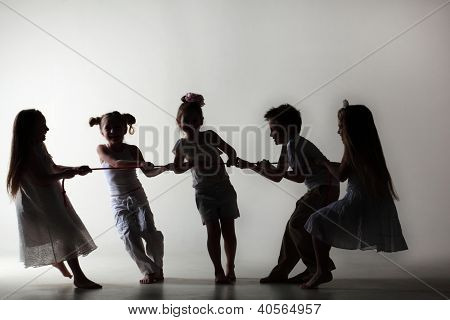 Silhouettes of five happy little children in white clothes drawing over pink rope.