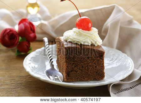 chocolate birthday cake with cherries and whipped cream