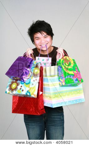 Asian Teen Boy With Gifts Bags